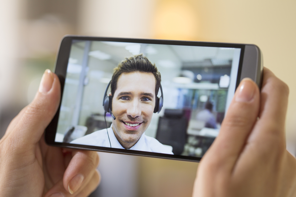 Customer success services man on phone.jpg