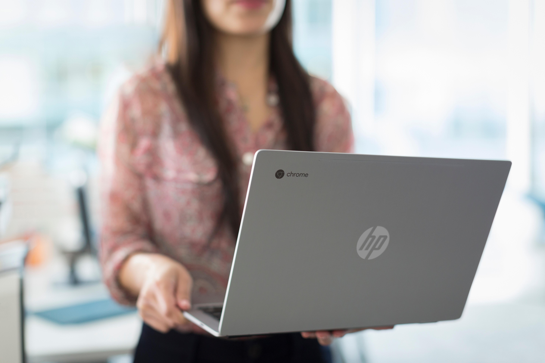 Women holding HP Chromebook